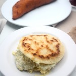 Arepa in the foreground, Empenada in the back ground.