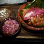 Cochinita Pibil at Xulam is a roasted pork in banana leaves